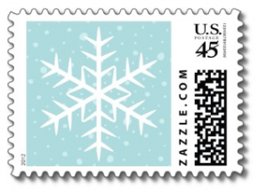Christmas holiday postage stamp with white winter snowflake and snow on a pale aqua background